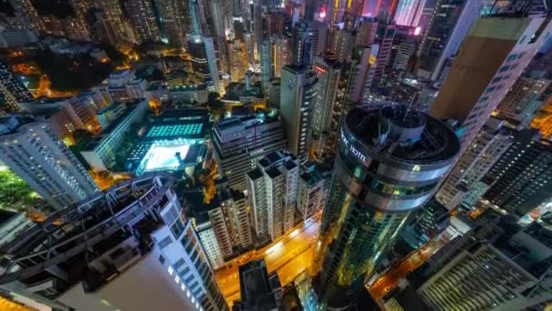 HONG KONG - MAY 2018: Rooftop timelapse view of Causeway Bay and Wan Chai disrtict, city from above at night.