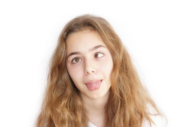 Pretty teenager girl with long hair makes funny face and slanting eyes