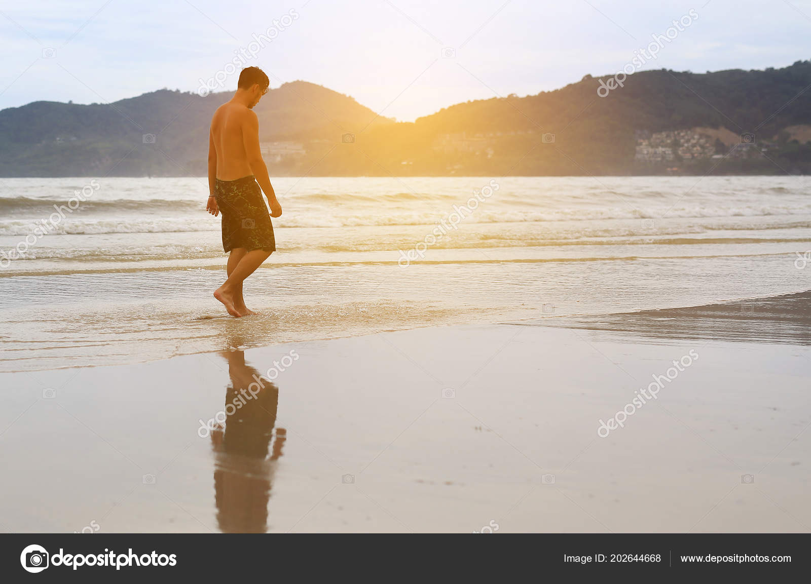 man walking beach sunset stock photo civic dm hotmail com 202644668
