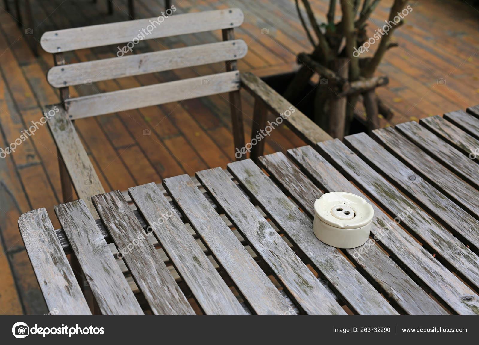 Peachy Wooden Table Chair Garden Ceramic Cigarette Ashtray Stock Spiritservingveterans Wood Chair Design Ideas Spiritservingveteransorg