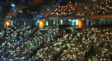 Blurred background of people and light in conference hall.