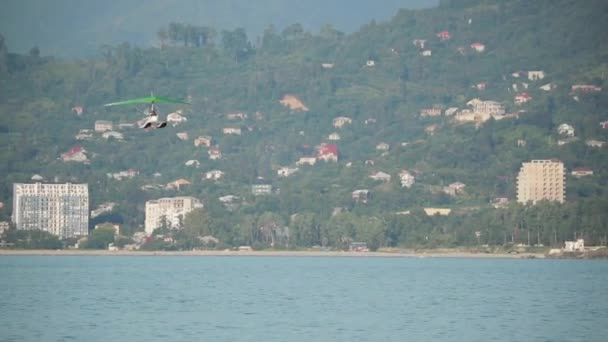 Motorized Hang Glider Flying In Blue Sunny Sky.