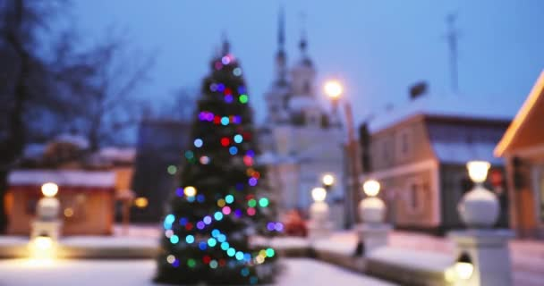 new year boke lights xmas christmas tree decoration and orthodox church in background festive illumination