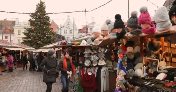 Tallinn, Estonia - December 22, 2017: Traditional Christmas Market On Town Hall Square. Trading Houses With Clothes And Hats