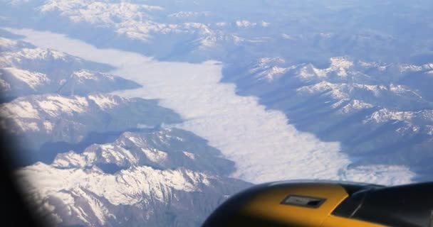 Aerial View From Airplane Window On Snowy Top Of Tatra Mountains In Summer Day. High Attitude
