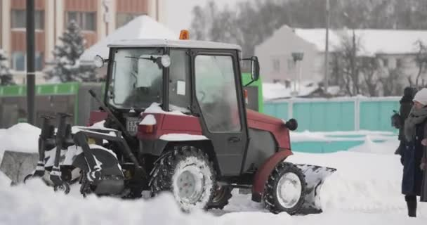 Tractor Cleaning Snow In Winter Snowy Day In City. Winter Service Vehicle In Work. Snow Removal Vehicle