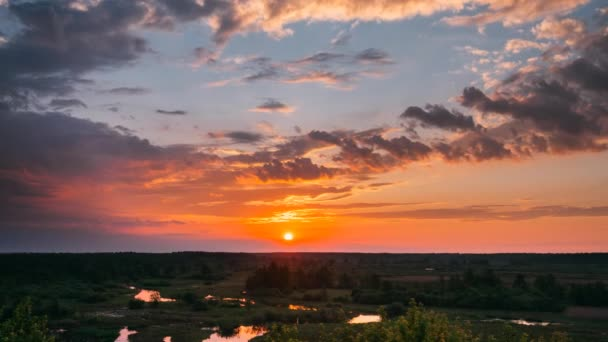 Amazing Sunrise Above Summer Forest And River Landscape. Scenic View Of Morning Sky With Rising Sun Above Forest. Early Summer Nature Of Europe.