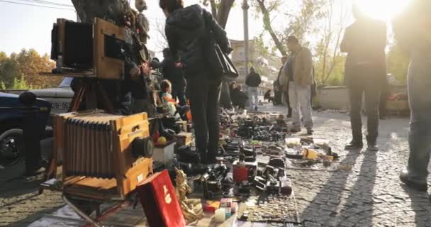 Tbilisi, Georgia - November 11, 2018: Shop Flea Market Of Antiques Old Retro Vintage Things On Dry Bridge In Tbilisi. Different Vintage Old Retro Cameras On Ground