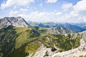 Fotografie Panoramic view of beautiful mountain landscape in the Alps with green mountain