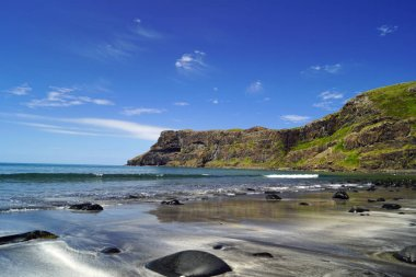 The  Talisker Beach is near the village of Carbost on the Isle of Skye