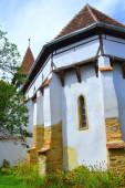 Erődített középkori szász templom Cincsor községben, Klienschenk, Erdély, Románia. A települést a szász telepesek alapították a 12. század közepén..