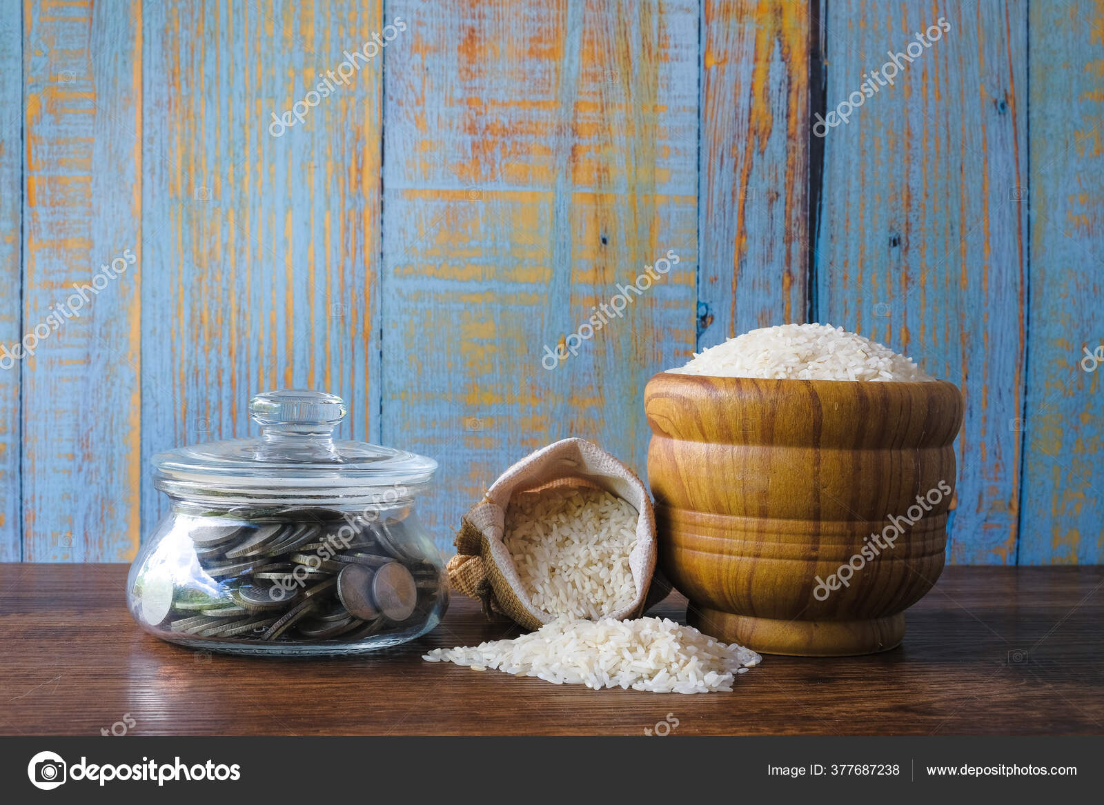 coin stacked rice wooden background zakat concept zakat sharing wealth stock photo c azamiadiputera 377687238 coin stacked rice wooden background zakat concept zakat sharing wealth stock photo c azamiadiputera 377687238
