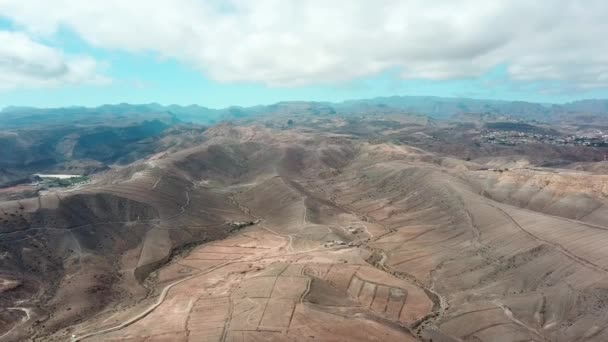 Aerial: peaceful nature landscape with mountains and sea. Bird eye view horizon with fields, mountains and blue sky. Gran Canaria