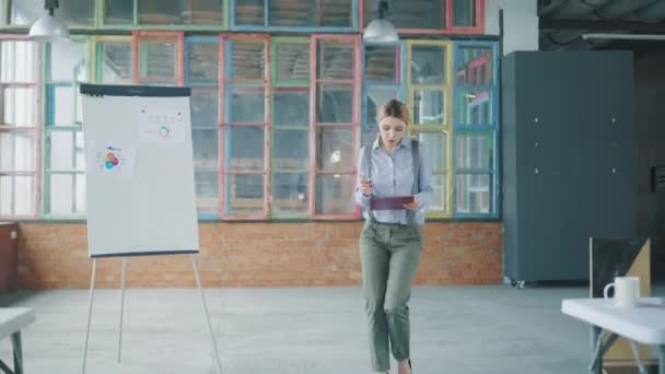 Young business woman walking in the office, enthusiastically studying the documents and bumps into another employee. Conflict situation. Creative coworking. Office