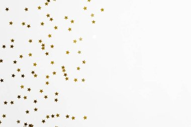 Group of gold star decoration isolated on white background top view