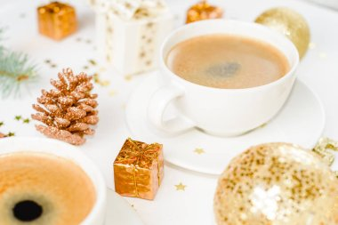 cup of hot coffee on a christmas holiday table. holidays and events consept.