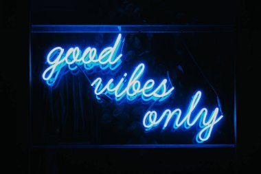 Blue Good Vibes Only words in neon light signage.