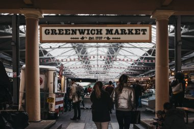 People entering Greenwich Market, London's only market set withi