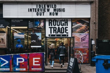 People entering Rough Trade music shop and venue in Brick Lane,