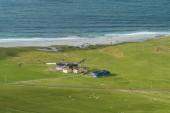 Farmářské domy na pláži Uttakleiv v Norsku