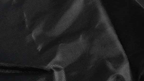Černá Nylonová tkanina texturu pozadí, velké detailní texturou