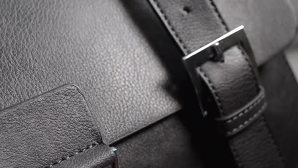 Detail from a black handbag. Eco leather, artificial leather, leather woman bag.