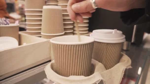 Female hand stirring sugar in a cup of coffee.