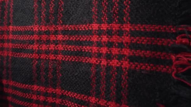 Checkered fabric texture, scarf or plaid. Red and black colors.