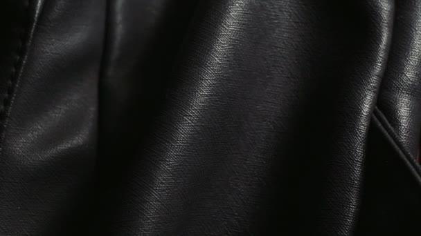 Detailní záběr černá přírodní nebo umělé kožené pouzdro.