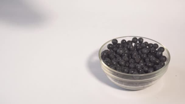 Muddling fresh blueberries to make a healthy fruit drink