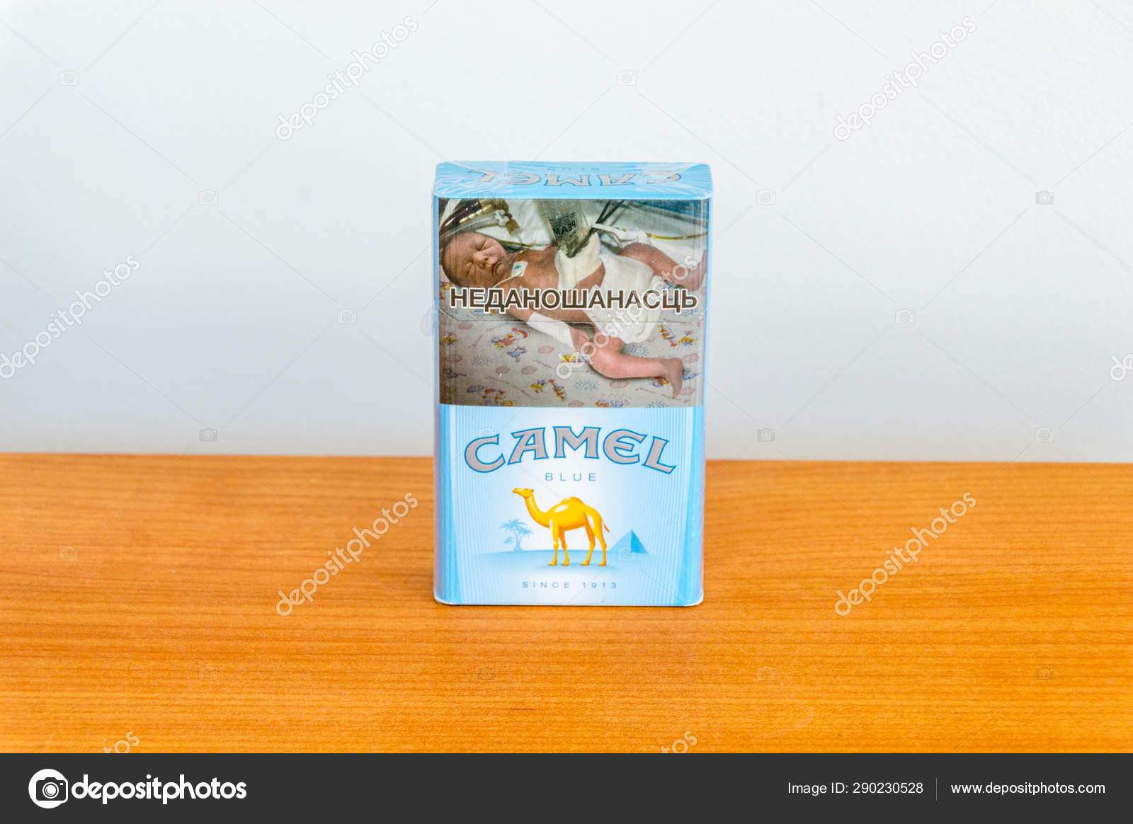 Camel Blue Pack Of Cigarettes On Wooden Table Stock Editorial Photo C Robson90 290230528