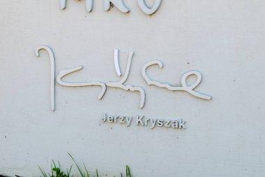Mragowo, Poland - June 1, 2020: Jerzy Kryszak signature on Amphitheater in Mragowo.