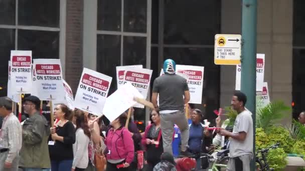 Chicago, IL - September 7th, 2018: Hotel workers across Chicago go on strike and march along the streets armed with signs and chanting in protest as they fight for better benefits and wages.