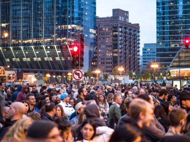 Chicago, IL - September 29th, 2018: Crowds gather on Upper Wacker Drive to watch the grand opening of Art on theMart, the longest running digital art display in the world in downtown Saturday Night.