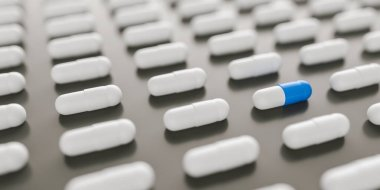 blue and white pills or capsules lies in a two rows, Pharmacy theme