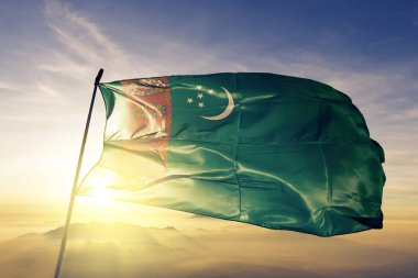 Turkmenistan national flag textile cloth fabric waving on the top