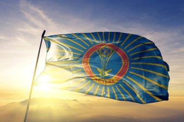 Astana city of Kazakhstan flag textile cloth fabric waving on the top sunrise mist fog