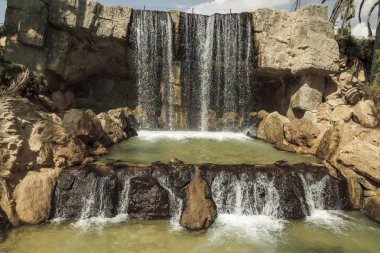 horizontal view of waterfall of el palmeral park in the city of alicante, spain
