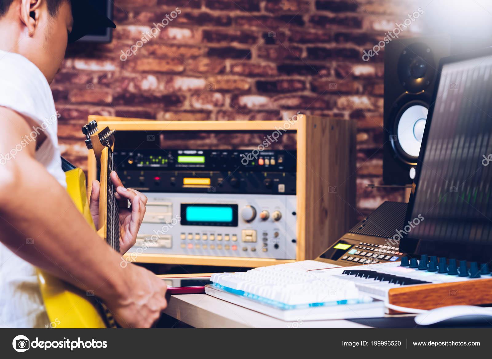 Asian Musician Recording Electric Guitar Sound Home Studio