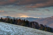 Fotografie Snow-covered and cloud-capped Krizna peak in Velka Fatra range of Carpathian mountains at sunset from Urpin hill Banska Bystrica region Slovakia Central / Eastern Europe