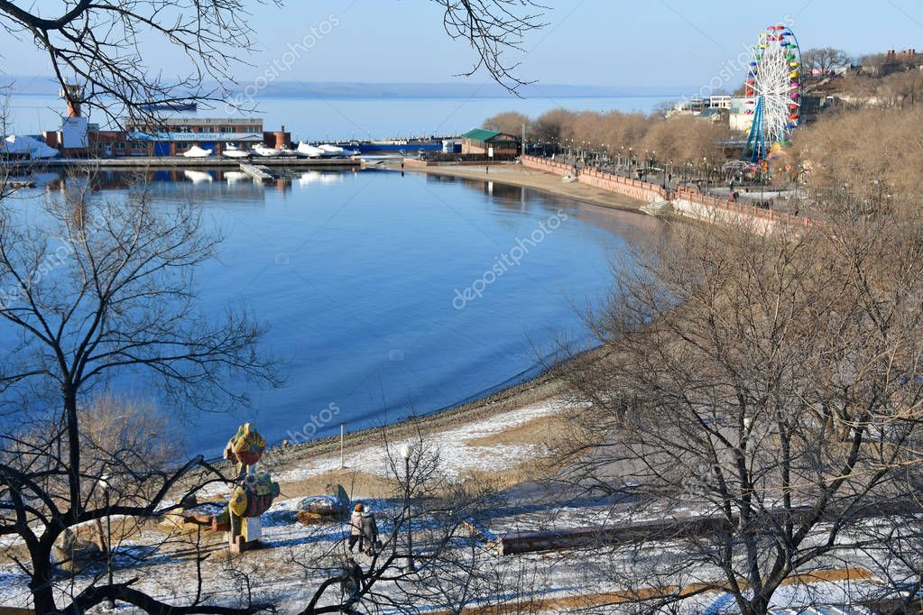 Vladivostok, Russia, December, 24, 2018. People walking on the promenade of Sports Harbor in december in sunny  day