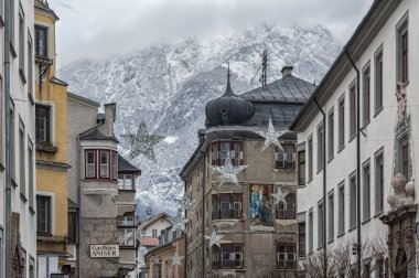 HALL IN TIROL, AUSTRIA - DECEMBER, 30 2018: Traditional buildings and colorful facades of houses in the medieval town of Hall in Tyrol, Austria