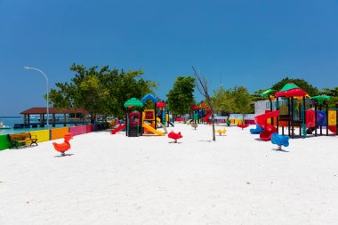 Colourful childrens playground on tropical island on a sunny day