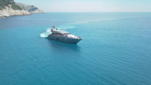 Amazing view to Yacht sailing in sea. Stock. Sunset view of the yacht. Luxury vacation on a yacht with friends in the sea