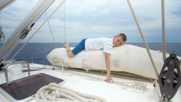 Boy sailing in a sea