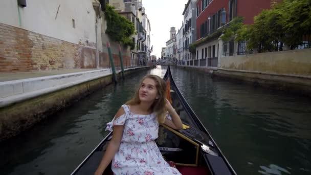 Young girl in gondola in Venice