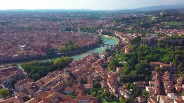 Verona, Italy. Aerial view of famous touristic city Verona in Italy at sunset. Bright sky with illuminated historical buildings and river