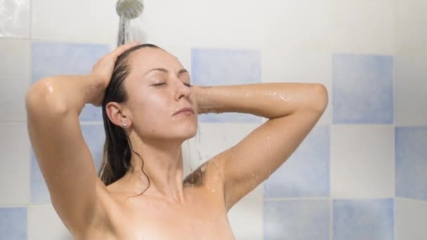 The Woman Relaxing Under Running Water In Hot Shower Stock