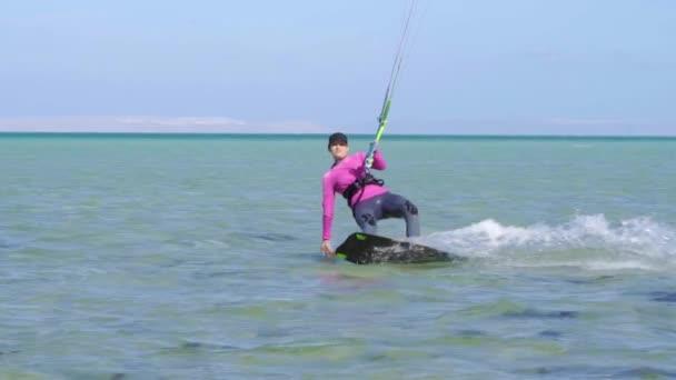Girl Kite Surfing In Slow Motion