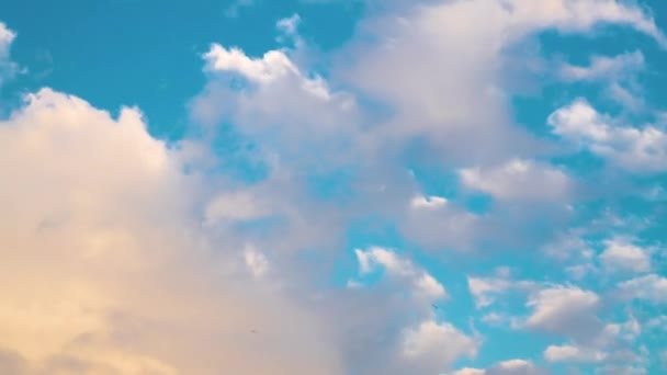 Time lapse clouds, rolling puffy cloud are moving, white lightnes clouds time lapse. Ultra HD sunny clouds, Cloud running across the blue sky. 4k Timelapse of white clouds with blue sky in background.